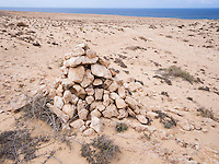 Spain, ESP, Canary Islands, Fuerteventura, Istmo de La Pared, 2012Oct13: A pile of stones marks the way through the desert of the Istmo de La Pared.