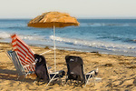 These beach chairs and umbrellas were just waiting to be used on the sand at Refugio State Beach, California.