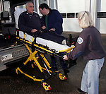 ROXBURY, CT05 January 2006-010506TK12 (left to right:)Roxbury  Ambulance has purchased a $9,500 stretcher with a power lift, the first of its kind in the state. The unit is powered by rechargeable battery, similar in size to batteries that power hand power drills. Demonstrating the new equipment are  Roxbury Ambulance Volunteers Donald Greenstein, Aaron Hodge and Mary Elizabeth Peck.  Tom Kabelka / Republican-American (Roxbury  Ambulance, Donald Greenstein, Aaron Hodge, Mary Elizabeth Peck)CQ
