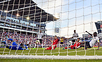 Commerce City, CO - Thursday June 08, 2017: Christian Pulisic scores a goal during their 2018 FIFA World Cup Qualifying Final Round match versus Trinidad & Tobago at Dick's Sporting Goods Park.