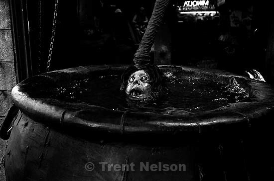 Phony human head being dunked in pot at haunted house on Fisherman's Wharf<br />