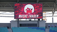 16th May 2020, Red Bull Arena, Leipzig, Germany; Bundesliga football, Leipzig versus FC Freiburg; A large Advertisement board enforces the Wearing of masks