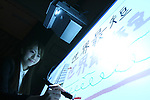 """May 18, 2010 - Tokyo, Japan - Japan's electronics giant Sanyo unveils a new ultra short-focus projector with 3D Ready, in Tokyo, Japan, on May 18, 2010. The new model which goes on sale in July offers the world's shortest projection distance as Large 80"""" image can be projected from 32 cm, said the company. It can also be set up vertically or horizontally for enjoying large images projected from right on the wall."""