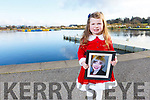 Paige Quillinan holding a photo of xxxxx xxxxxxx at the Tralee 5k Santa Fun Run launched in aid of Crumlins Children Hospital going on Sunday 16th of December.<br />  Paige Quillinan