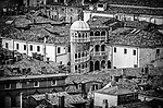 A monochrome image of Venice rooftops dominated by the 15th century palazzo Contarini del Bovolo which is known for it's unique circular staircase.
