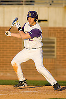 Austin Homan #23 of the East Carolina Pirates follows through on his swing versus the Virginia Cavaliers at Clark-LeClair Stadium on February 19, 2010 in Greenville, North Carolina.   Photo by Brian Westerholt / Four Seam Images