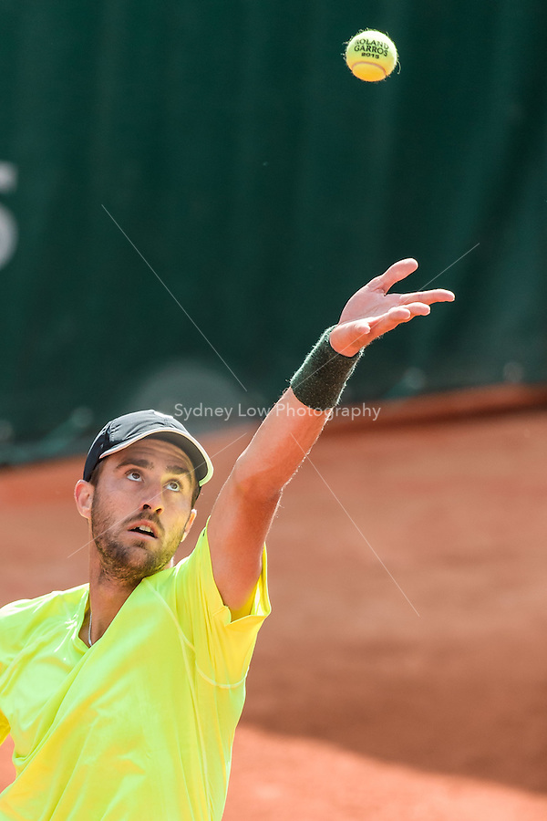 May 24, 2015: Steve Johnson (USA) in action in a 1st round match against Guillermo Garcia-Lopez (ESP) on day one of the 2015 French Open tennis tournament at Roland Garros in Paris, France. Sydney Low/AsteriskImages