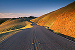 two lane twisting curved mountain road at sunset green hills Bolinas Ridge Mount Tamalpais California Twisting curves on rural country mountain road at sunset, Bolinas Ridge, Mount Tamalpais, Marin, California