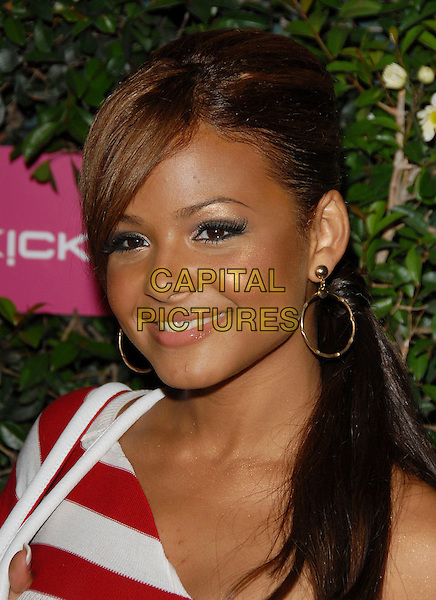 CHRISTINA MILIAN.At The T-Mobile Sidekick 3 Debut Party held at The Hollywood Palladium in Hollywood, California, USA, .June 20, 2006..portrait headshot red and white striped top stripes hoop earrings.Ref: DVS.www.capitalpictures.com.sales@capitalpictures.com.©Debbie VanStory/Capital Pictures