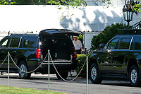United States President Donald J. Trump walks to the presidential motorcade as he departs the White House in Washington D.C., U.S., for Trump National Golf Club in Sterling, Virginia on Saturday, May 23, 2020.  Credit: Stefani Reynolds / CNP/AdMedia