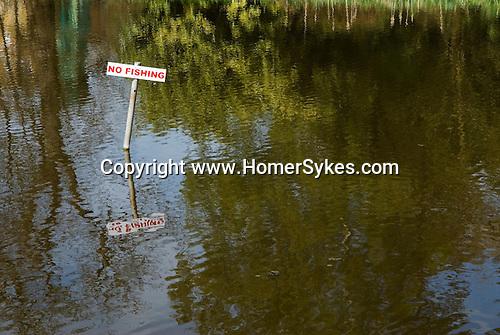 No Fishing sign village pond. Surrey UK