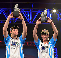 NWA Democrat-Gazette/BEN GOFF -- 04/26/15 Tyler Black  (left) and North Carolina teammate Kristopher Queen display their trophies after being named the 2015 High School Fishing National Champions during final weigh-ins for the tournament at the John Q. Hammons Center in Rogers on Sunday Apr. 26, 2015.