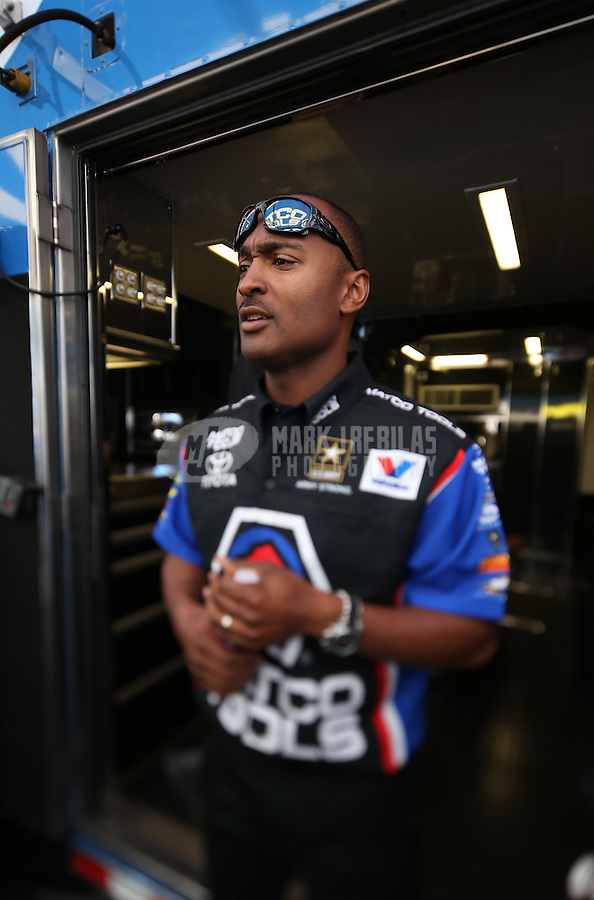 Apr. 5, 2013; Las Vegas, NV, USA: (Editors note: Special effects lens used in creation of this image) NHRA top fuel dragster driver Antron Brown in the pits during qualifying for the Summitracing.com Nationals at the Strip at Las Vegas Motor Speedway. Mandatory Credit: Mark J. Rebilas-