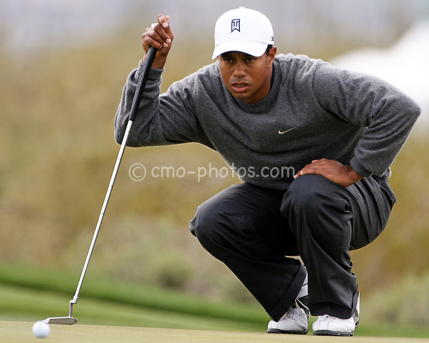 Feb 22, 2008; Marana, AZ, USA; Tiger Woods studies a putt on the 16th hole during his third round match against Aaron Baddeley (not pictured) at the Accenture Match Play Championship at the Gallery Golf Club.