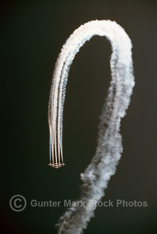 Canadian Forces Snowbirds flying in Close Formation, and performing Aerobatic Loop Maneuver in Sky with Smoke - at Abbotsford International Airshow, BC, British Columbia, Canada