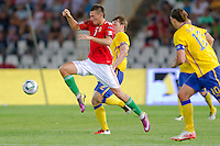 Hungary's Adam Pinter (L) fights for the ball with Sweden's Kim Kallstrom (R) during the UEFA EURO 2012 Group E qualifier Hungary playing against Sweden in Budapest, Hungary on September 02, 2011. ATTILA VOLGYI