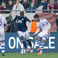 Foxborough, Massachusetts - April 6, 2018: In a Major League Soccer (MLS) match, New England Revolution (blue/white) defeated,4-0, Montreal Impact (white), at Gillette Stadium.