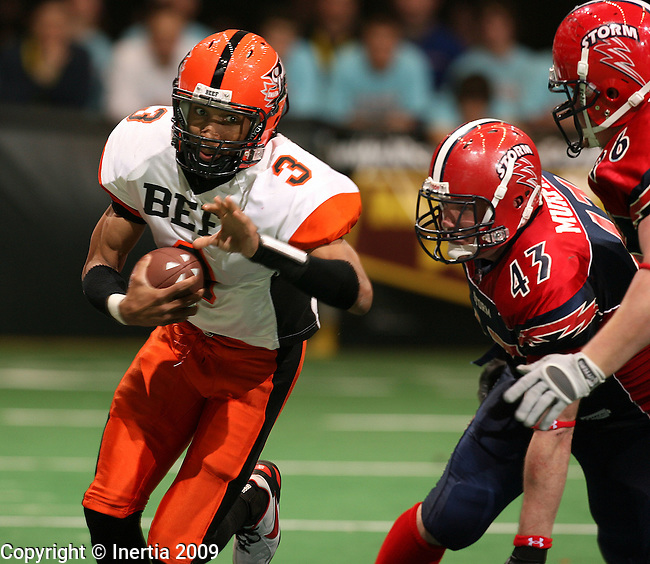 SIOUX FALLS, SD - MARCH 29:  James McNear #3 of the Omaha Beef turns the corner for extra yardage as Leif Murphy #43 and Cory Johnsen #96 of the Sioux Falls Storm pursue in the third quarter of their Indoor Football League game Sunday afternoon at the Sioux Falls Arena. (Photo by Dave Eggen/Inertia)