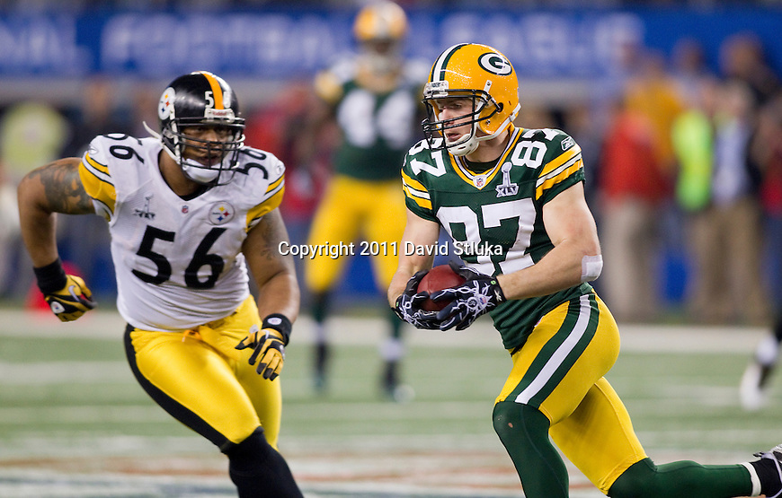 Pittsburgh Steelers linebacker LaMarr Woodley (56) pursues Green Bay Packers wide receiver Jordy Nelson (87) during Super Bowl XLV on Sunday, February 6, 2011, in Arlington, Texas. The Packers won 31-25. (AP Photo/David Stluka)