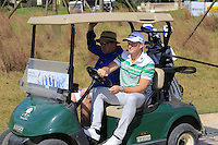 Jamie Donaldson (WAL) takes the wheel for the start of Tuesday's Pro-Am Day of the 2014 BMW Masters held at Lake Malaren, Shanghai, China 28th October 2014.<br /> Picture: Eoin Clarke www.golffile.ie