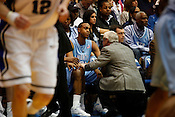 UNC Coach Roy Williams consoles John Henson during the first half of the Tar Heels match-up against long-tim rival Duke at Cameron Indoor Stadium, Sat., March 6, 2010. Duke dominated UNC 82-50.