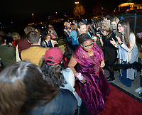 NWA Democrat-Gazette/ANDY SHUPE<br /> Tattiana Tolbert of Springdale smiles Friday, Feb. 9, 2018, as a large crowd of volunteers cheer her arrival with her &quot;buddy&quot; Jenny Schisler during the Night to Shine, a prom night for people with special needs ages 14 and older, at Cross Church in Springdale. The event, which is sponsored by the Tim Tebow Foundation, features hair and makeup assistance, limousine rides, a dinner and dancing.