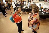 NWA Democrat-Gazette/DAVID GOTTSCHALK  Betty Christian (left) speaks with Kelly Colebar, city of Fayetteville Community Resources Division community resources administrator, Wednesday, April 19, 2017, during a reception at the Fayetteville Senior Activity and Wellness Center. The division hosted the reception to display the different programs the Community Development Block Grant funds. The reception also coincides with National Community Development Week.