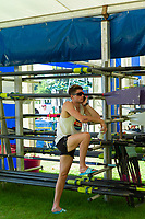 """Henley on Thames, United Kingdom, 29th June 2018, Friday, """"Henley Royal Regatta"""", Qualifying races, [Time Trails] Oarsman, Athlete, resting on a oar rack,  making a mobile Phone call,  Henley Reach, River Thames, Thames Valley, England, © Peter SPURRIER, 29/06/2018"""