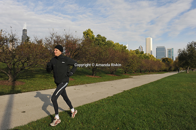 Denis Brogniart, host of French Survivor television show, jogs along Lake Michigan a day ahead of the Chicago Marathon in Grant Park in Chicago, Illinois on October 10, 2009.