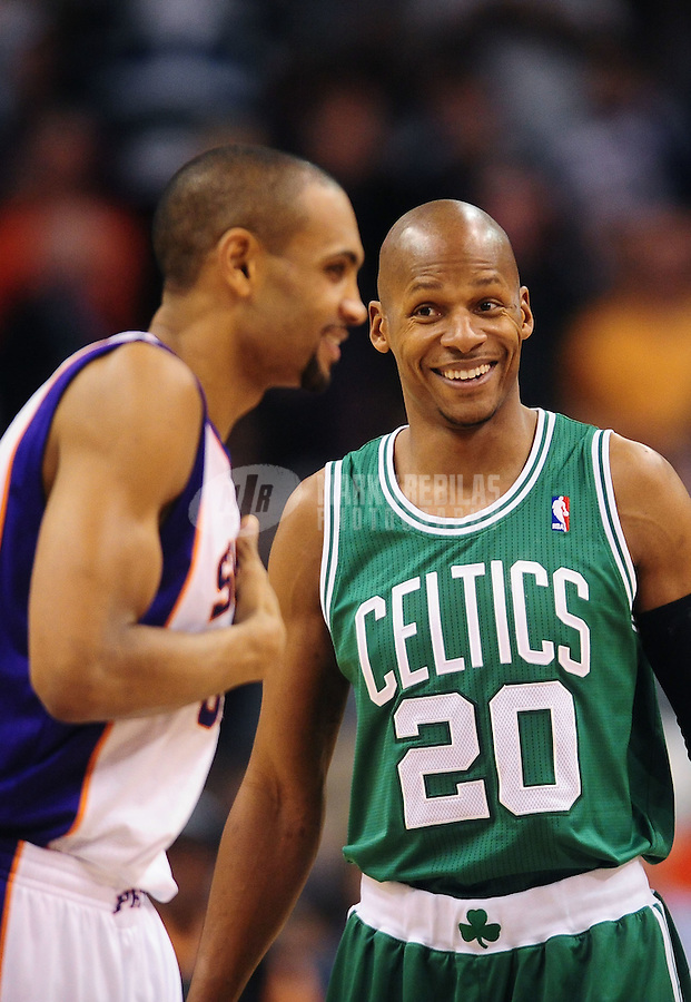 Jan. 28, 2011; Phoenix, AZ, USA; Boston Celtics guard (20) Ray Allen talks with Phoenix Suns forward Grant Hill at the US Airways Center. Mandatory Credit: Mark J. Rebilas-