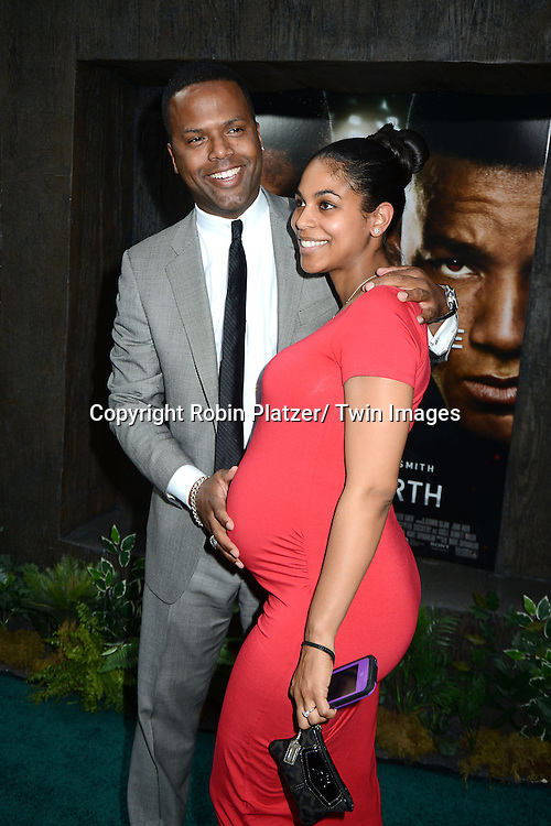 """AJ Calloway and fiancee Dionne Walker attends the Domestic Premiere of """"After Earth""""  on May 29, 2013 at the Ziegfeld Theatre in New York City."""