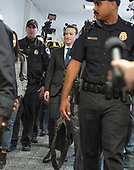 Surrounded by staff and security, Mark Zuckerberg, Co-Founder and Chief Executive Officer of Facebook, walks to United States Senator Dianne Feinstein's (Democrat of California) office as he makes the rounds on Capitol Hill prior to giving testimony before Congress on Tuesday and Wednesday on Monday, April 9, 2018<br /> Credit: Ron Sachs / CNP<br /> (RESTRICTION: NO New York or New Jersey Newspapers or newspapers within a 75 mile radius of New York City)