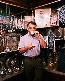 TURKEY, Istanbul, portrait of a man drinking coffee at Grand Bazaar