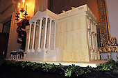 "Washington, DC - December 3, 2008 -- Annual White House Gingerbread House in the State Dining Room of the White House during a media preview of the 2008 holiday decorations and tasting event  in Washington, D.C. on Wednesday, December 3, 2008.  The theme of this years decorations is ""a Red, White, and Blue Christmas""..Credit: Ron Sachs / CNP"