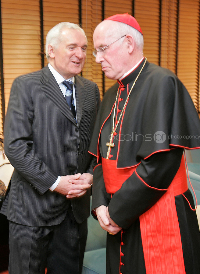 29/11/'07 Taoiseach Bertie Ahern greeting Cardinal Seán Brady this morning at Dublin Airport after his creation as a cardinal last weekend  by the Holy Father, Pope Benedict XVI...Picture Collins, Dublin, Colin Keegan.