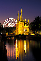 Netherlands, Sneek, Holland, Friesland, Europe, Water Tower (1613) along the canal in downtown Sneek illuminated at night.