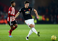 24th November 2019; Bramall Lane, Sheffield, Yorkshire, England; English Premier League Football, Sheffield United versus Manchester United; Harry Maguire of Manchester United passes the ball out of defense- Strictly Editorial Use Only. No use with unauthorized audio, video, data, fixture lists, club/league logos or 'live' services. Online in-match use limited to 120 images, no video emulation. No use in betting, games or single club/league/player publications