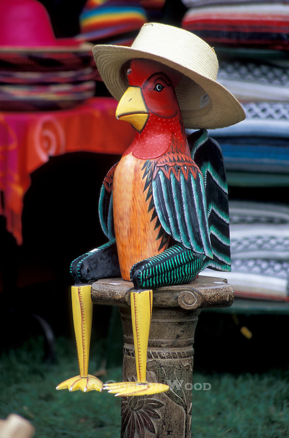 Wooden Rooster Figure with Straw Hat at Outdoor Music Festival Stall