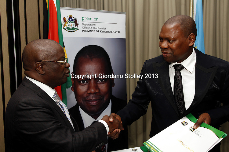 DURBAN - 6 August 2013 - Andre Kimbuta (left), the governor of the Democratic Republic of  the Congo's Kinshasa Province and Dr Zweli Mkhize of South Africa's KwaZulu-Natal province shake hands after signing a memorandum of understanding that will foster relations and trade between the two provinces. Picture: Giordano Stolley