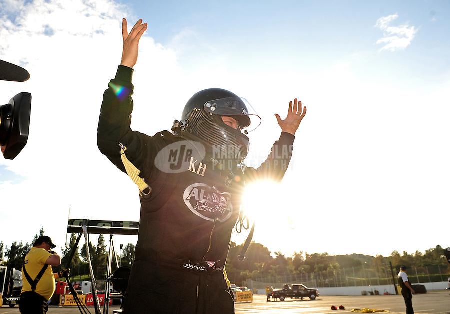 Nov. 13, 2011; Pomona, CA, USA; NHRA top fuel dragster driver Del Worsham celebrates after winning the 2011 world championship during the Auto Club Finals at Auto Club Raceway at Pomona. Mandatory Credit: Mark J. Rebilas-.