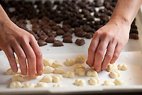 Preparation of hand crafted chocolates and desserts, SAID Confectionery, Rome, Italy