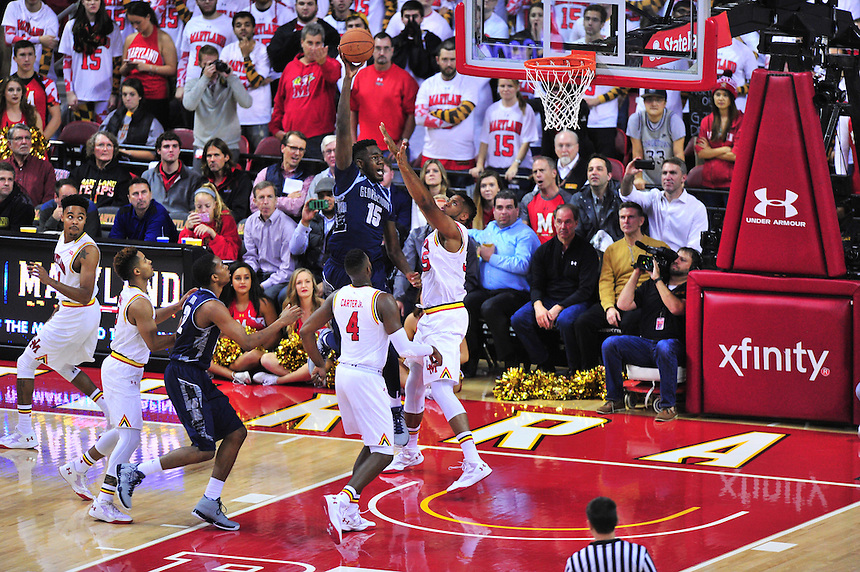 Hoyas' Jessie Govas rises above the rim. Maryland defeated Georgetown 75-71 during a game at Xfinity Center in College Park, MD on Wednesday, November 17, 2015.  Alan P. Santos/DC Sports Box