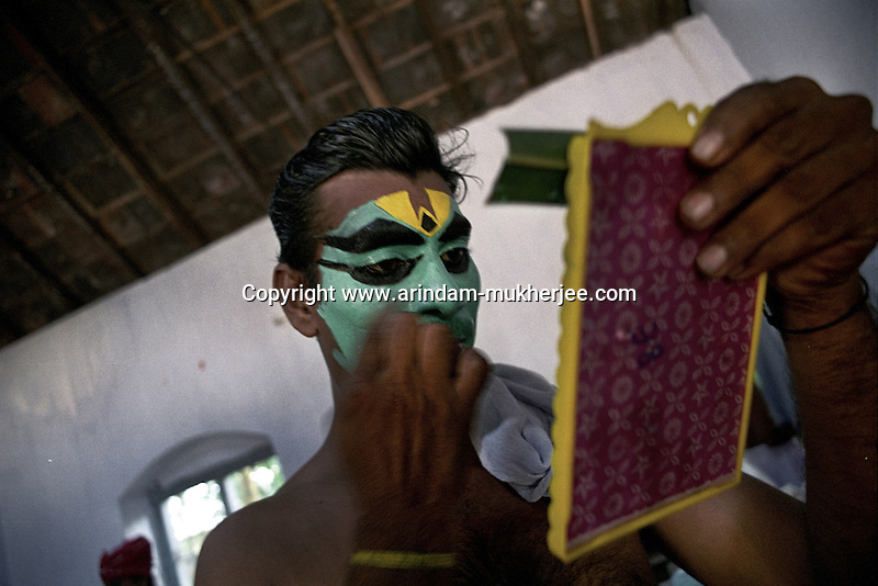 An Arjuna nrityam artist prepares himself before the show during Onam festival (harvest festival) at ernakulam, Kerala, India