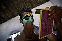 An Arjuna nrityam artist prepares himself before the show during Onam festival (harvest festival) at ernakulam, Kerala, India