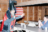 Ian Miller, 17, of Rochester, records video on his cell phone while satirical presidential candidate Vermin Supreme speaks at Ten Rod Farm in Rochester, New Hampshire. Supreme's platform advocates a pony-based economy, using zombies to solve the energy crisis, and other outlandish ideas. Supreme has been on the New Hampshire primary ballot in 2008 and 2012, though he began running for president in 1992. Vermin Supreme will be on the Democratic party ballot in the 2016 New Hampshire primary.