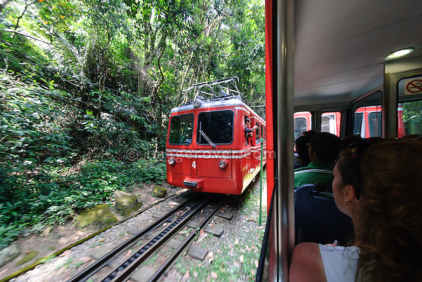 """Rio de Janeiro, Brazil: The famous train """"Trem do Corcovado"""" travelling up to the mountain top of Corcovado with it's christ statue Christo Redentor. The 3.3km long electric cog wheel railway between Cosme Velho Station and the mountain top was opened in 1884 and runs through the rain forest with some breathtaking views onto Rio. --- No releases available."""