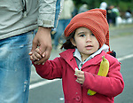 A refugee girl holds a banana she received from the ACT Alliance at the border crossing into Austria near the Hungarian town of Hegyeshalom. Hundreds of thousands of refugees and migrants--including many children--flowed through Hungary in 2015, on their way to western Europe from Syria, Iraq and other countries. The ACT Alliance has provided food and other critical support for refugee and migrant families here and in other places along their journey.