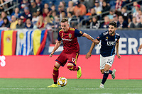 FOXBOROUGH, MA - SEPTEMBER 21: Corey Baird #17 of Real Salt Lake dribbles as Carles Gil #22 of New England Revolution defends during a game between Real Salt Lake and New England Revolution at Gillette Stadium on September 21, 2019 in Foxborough, Massachusetts.