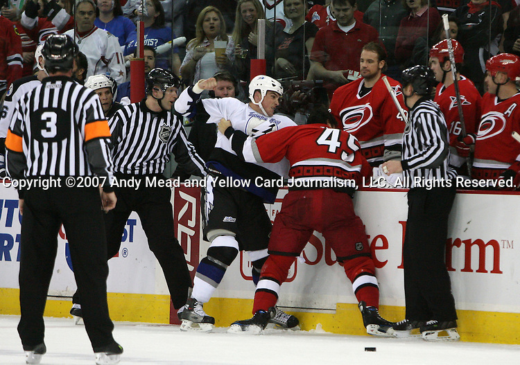 Tampa Bay's Shane O'Brien (in white) and Carolina's David Tanabe (45) fight during the first period on Friday, March 30, 2007 at the RBC Center in Raleigh, North Carolina. The Tampa Bay Lightning defeated the Carolina Hurricanes 4-2 in a regular season National Hockey League game.