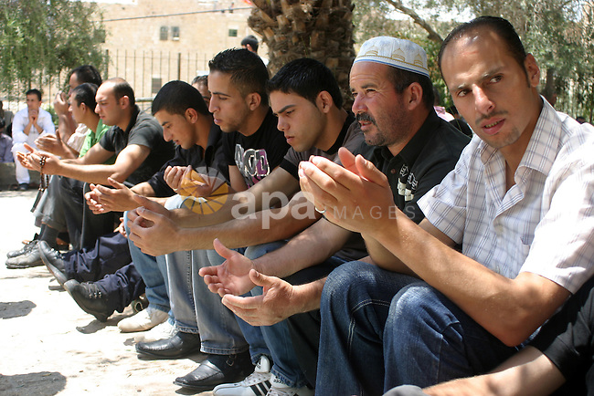 Palestinian attend the second friday prayer of Islam's holy fasting month of Ramadan outside the Ibrahimi mosque, or the Tomb of the Patriarchs, in the divided West Bank city of Hebron on August 12, 2011.  Photo by Najeh Hashlamoun